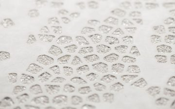 Бетонные плиты с геометрическим рисунком на лицевой поверхности украсят любой фасад