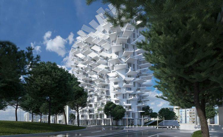 Жилые апартаменты L'Arbre Blanc похожи на гигантскую белую шишку